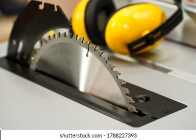 Table saw cutting wood , Circular saw blade for wood work .Carpenter tools