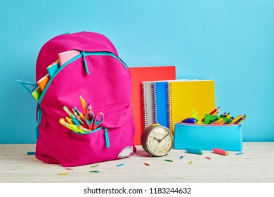 A table for a schoolboy who is ready to return to school. School objects for students. 1 September concept postcard
