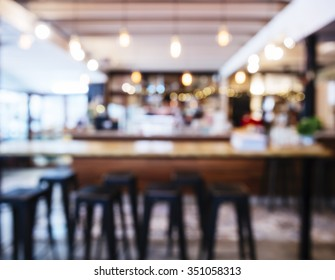 Table and seats with People Restaurant Shop interior Blurred background