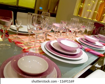 Table served on some persons. Set of glasses. Violet service