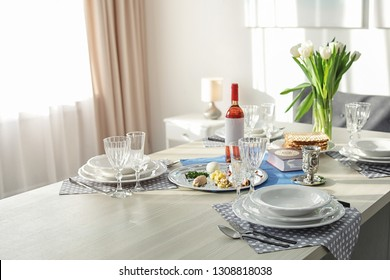 Table served for Passover (Pesach) Seder indoors, space for text