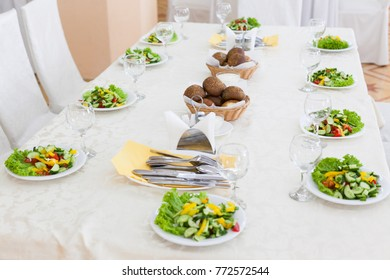 Table served with salad plates for 10 persons with selective focus