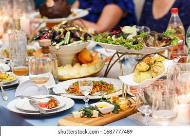 Table served with salads and other food at a wedding or other ev