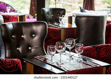 Table serving for lunch with wine and water glasses in a luxurious restaurant for guests
