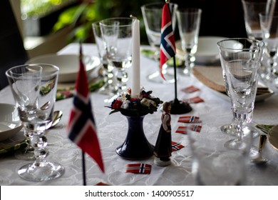 Table set for 17th of May, Norways national day, celebration. Decorated with Norwegian flags.