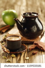 Table set up apple hot tea with cinnamon and cookies, soft focus