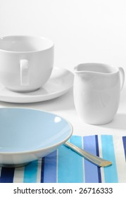 Table set for breakfast with empty bowl