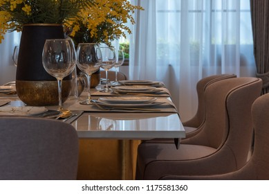 table set in dining room with dining table, interior design decoration concept