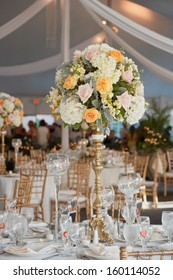 Table set for an event party or wedding reception, focus on centerpiece bouquet