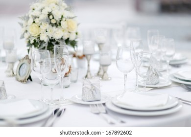 Table set for an event party or wedding reception, winter theme