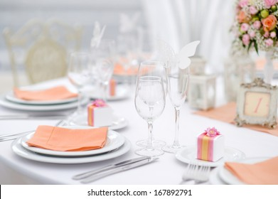 Table set for an event party or wedding reception, spring theme