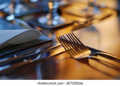 Table set for fine dining with cutlery and glassware
