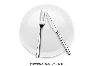 table set with fork and knife over plate, on white background