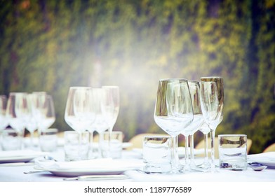 Table set in a garden. Vintage tone and selective focus.