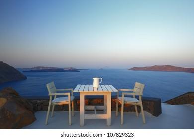 table set on the cliff of Santorini, Greece
