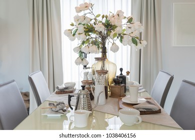 table set on dining table in modern dining room, interior design concept