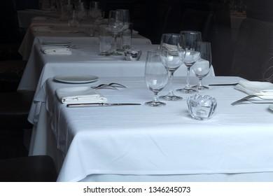 table set plate glass fork cutlery napkin restaurant elegant dinner