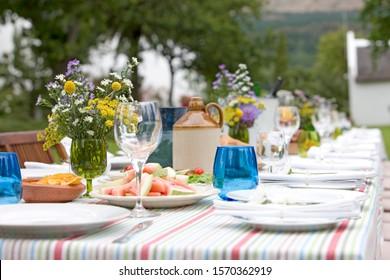 A table set for a summer garden party, close-up