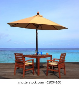 table set and umbrella on the deck