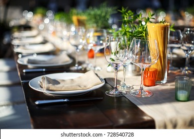 Table set for wedding or another catered event dinner. Italian villa. Villa Bordoni.