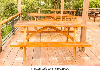 Table sets on wooden floor, Thailand.