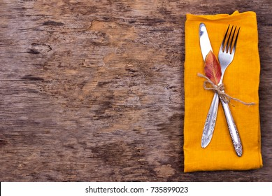 table setting with autumn decor.  Fork, knife, napkin, cutlery. Holiday Decorations.Thanksgiving dinner.  Autumn mood, Halloween, Thanksgiving, Holiday concept.Top View. selective focus.