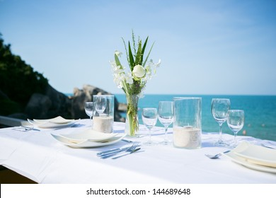 Table setting at beach restaurant.
