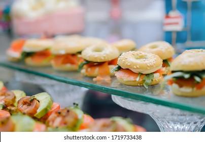 table setting with buns and salmon, arugula, sesame seeds