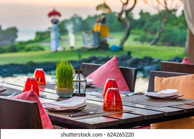 Table setting at casual outdoor restaurant in Bali, Indonesia