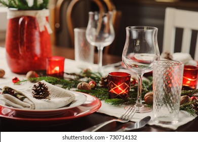 Table setting for celebration Christmas and New Year Holidays. Festive table at home with rustic details