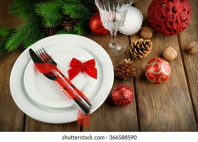 Table setting with Christmas decoration on wooden background