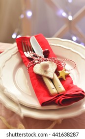 Table setting for Christmas dinner at home with fork and knife