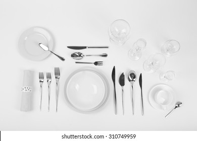 Table setting, close up, on white background