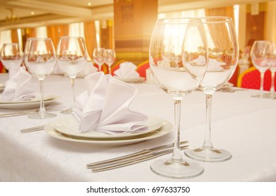 Table setting for dinner or banquet in restaurant on the sunset