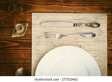 Table setting with empty plate- rustic wooden table