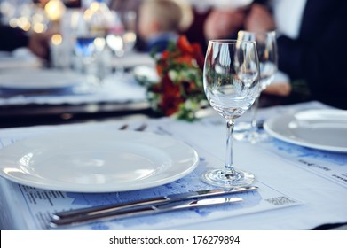 Table setting with fork, knife, plates and glass