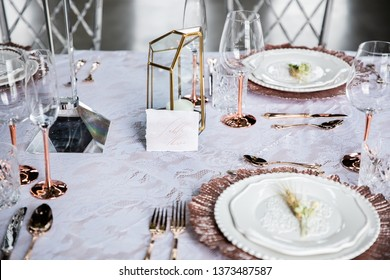 Table setting with geometric candle holder
