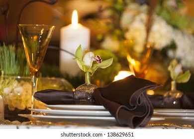 Table setting at a high end wedding.