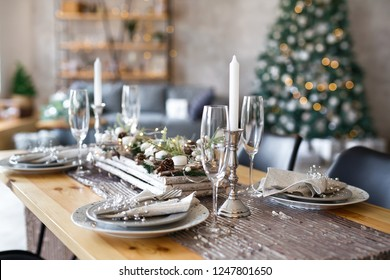 Table setting with holiday decorations. Preparation for christmas dinner