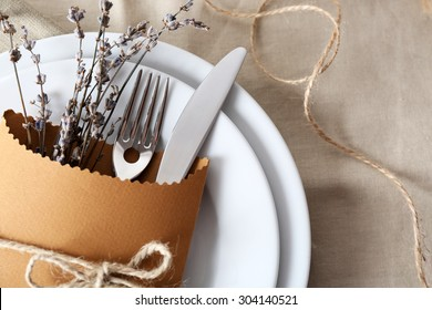 Table setting with lavender flowers, close-up