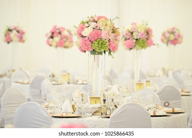 Table setting at a luxury wedding reception. Beautiful flowers on the table
