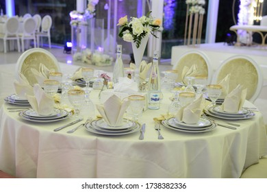 Table setting at a luxury wedding reception - Shutterstock ID 1738382336