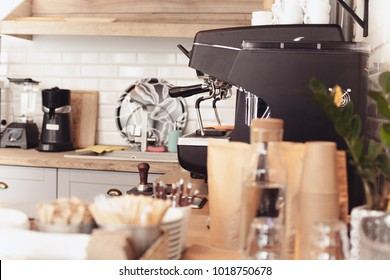 A table setting on the counter at a coffee house. Barista, cafe, making coffee, preparation and service concept. Female hands at work. The hipster stile