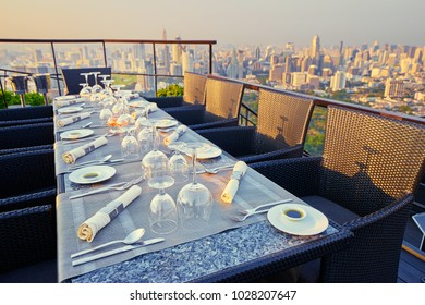 Table setting on roof top restaurant with, Bangkok Thailand.