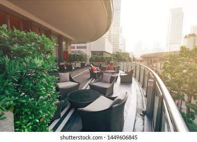 Table setting on roof top restaurant with megapolis view in Bangkok, Thailand. Horizontal shot