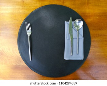 Table setting on the wooden table