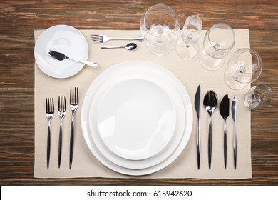 Table setting on wooden background
