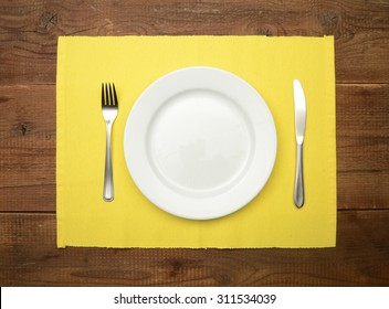 Table setting on wooden rustic dinning table for one person