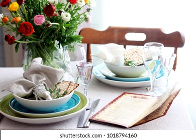 Table setting for passover with flowers