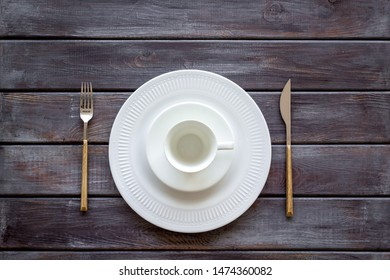Table setting with plates and flatware on wooden background top view